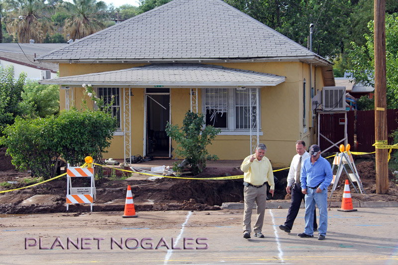 nogales city officials in front of flood house